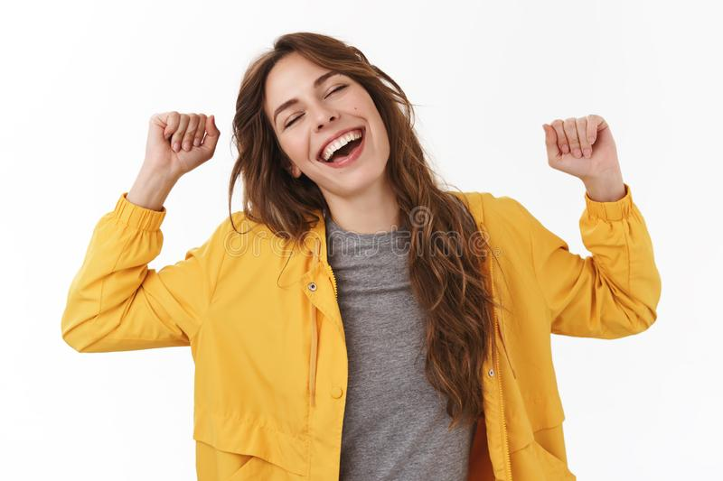 Lazy girl wanna take nap doing nothing all day. Silly cute european woman yawning hands raised stretching body feel. Energized waking up afternoon standing stock images