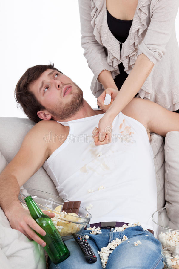 Lazy guy doesn't want to help his wife royalty free stock photos