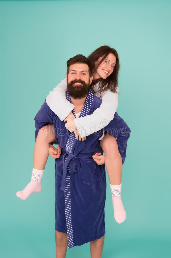 Lazy weekend. romantinc couple in love. woman and man in robe. Perfect morning. Having fun. Happy family weekend. Lazy weekend. romantinc couple in love. women royalty free stock image