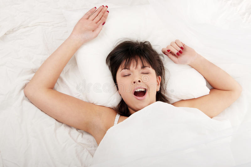 Lazy woman in bed royalty free stock photography