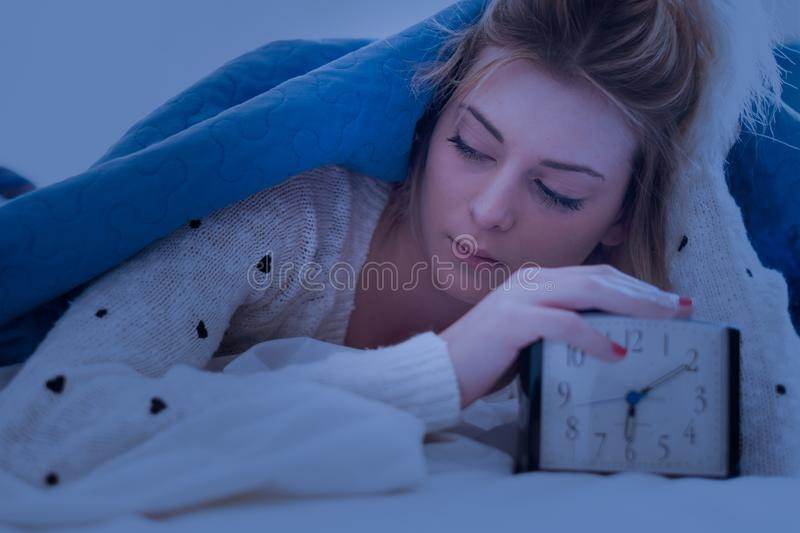 Lazy young girl waking up in the morning stock images