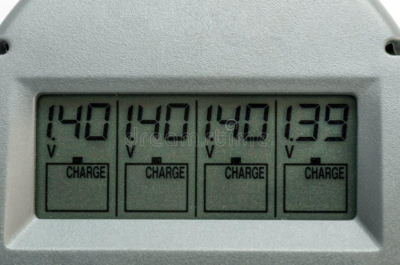 LCD电池的显示充电器有伏特和数字的 免版税库存照片