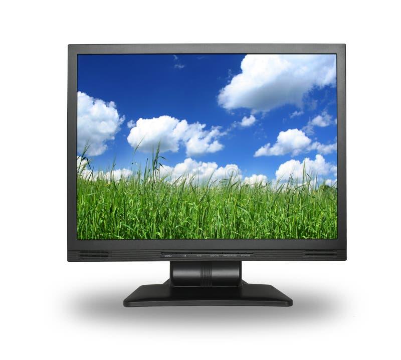 LCD con el campo del verano foto de archivo