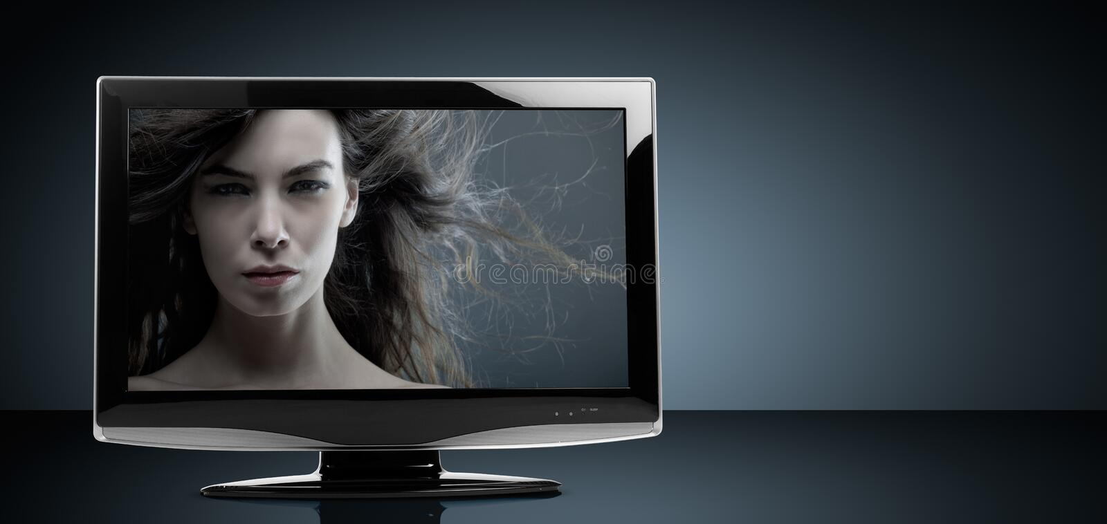 LCD Television Set. On reflective table