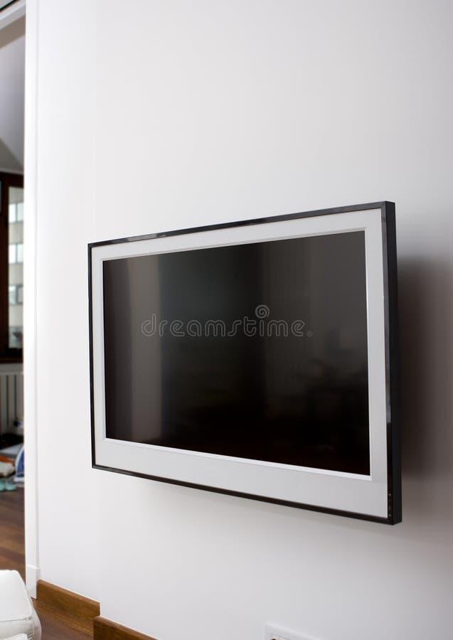 LCD TV en una pared imágenes de archivo libres de regalías