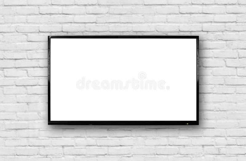 LCD TV met een dun zwart kader die op een witte bakstenen muur hangen Het lege witte scherm Ge?soleerdj op witte achtergrond royalty-vrije stock afbeeldingen