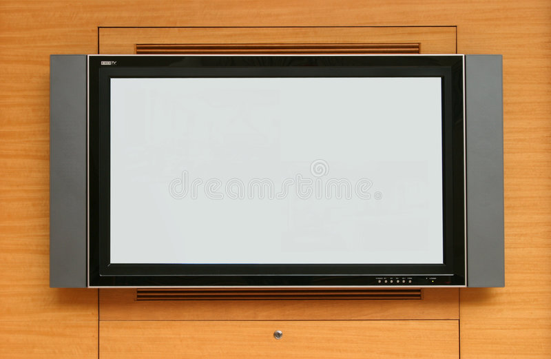 LCD TV screen. On light wood cabinet, ready for advertising