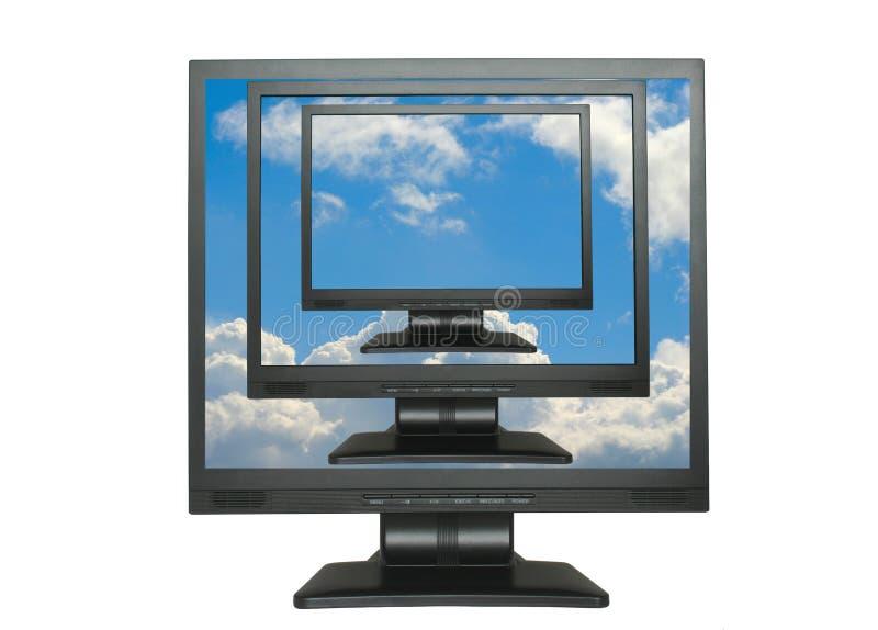 LCDs clonados no céu azul foto de stock