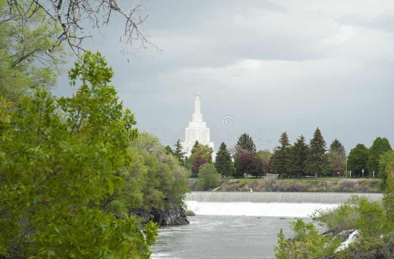 LDS Temple in Idaho Falls near Greenbelt. Beautiful Mormon LDS temple in Idaho Falls in background of Idaho Falls Greenbelt under cloudy skies near river royalty free stock photos