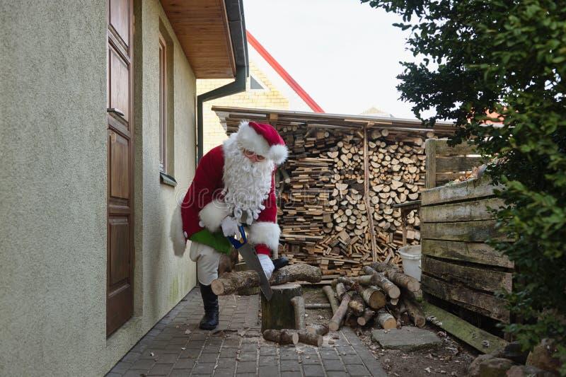 Leña de la fractura de Santa Claus imágenes de archivo libres de regalías