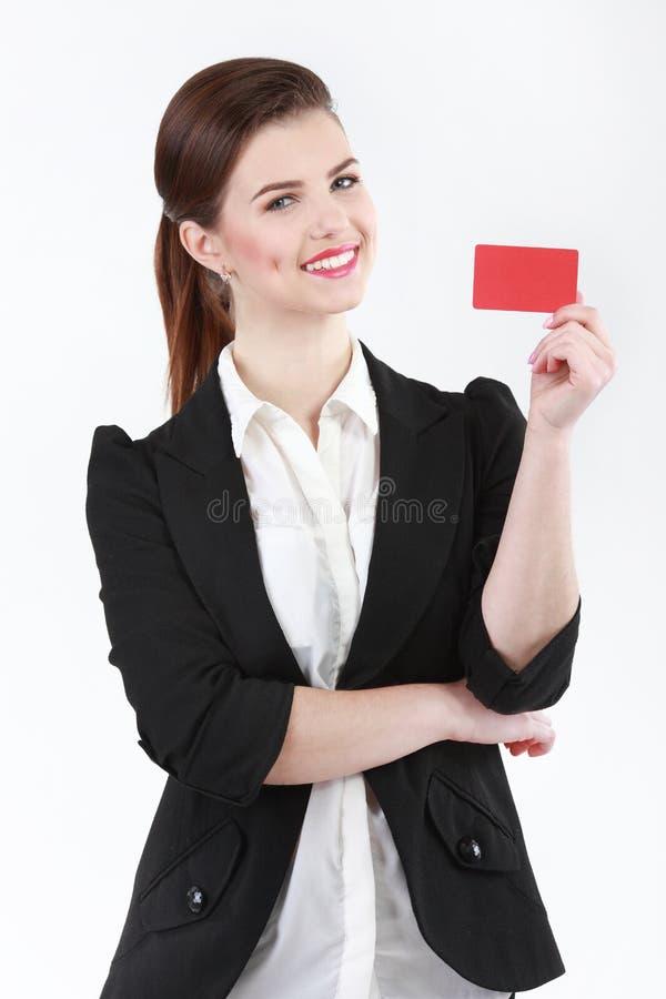 Le affärskvinnan med ett tomt affärsemblem som isoleras på wh royaltyfria bilder
