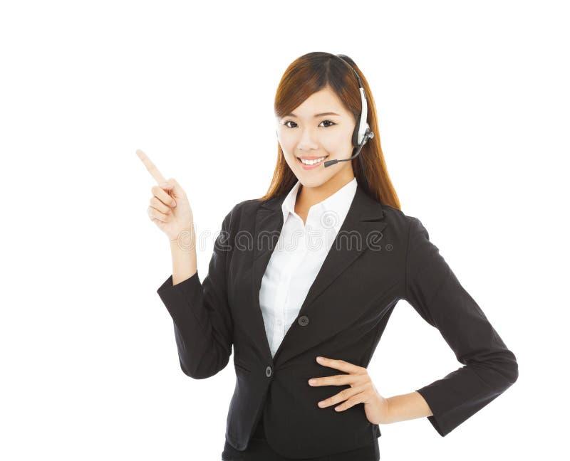 Le affärskvinnan med headphonen och punkt upp royaltyfria foton