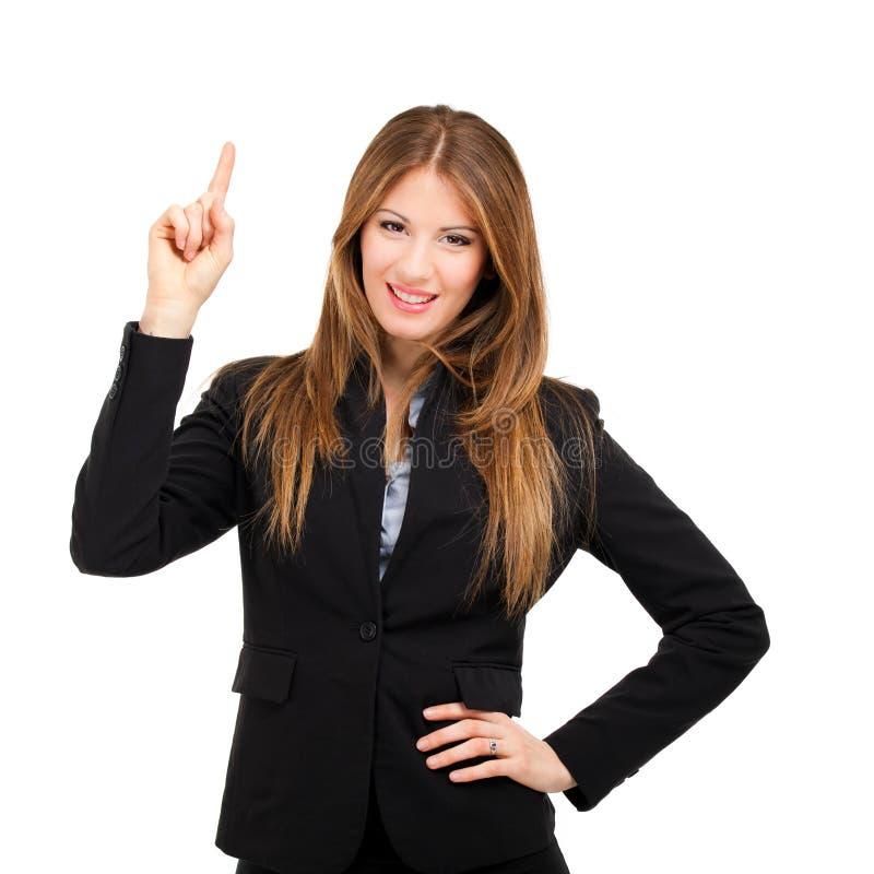 Le affärskvinnan som pekar upp hennes finger royaltyfri bild