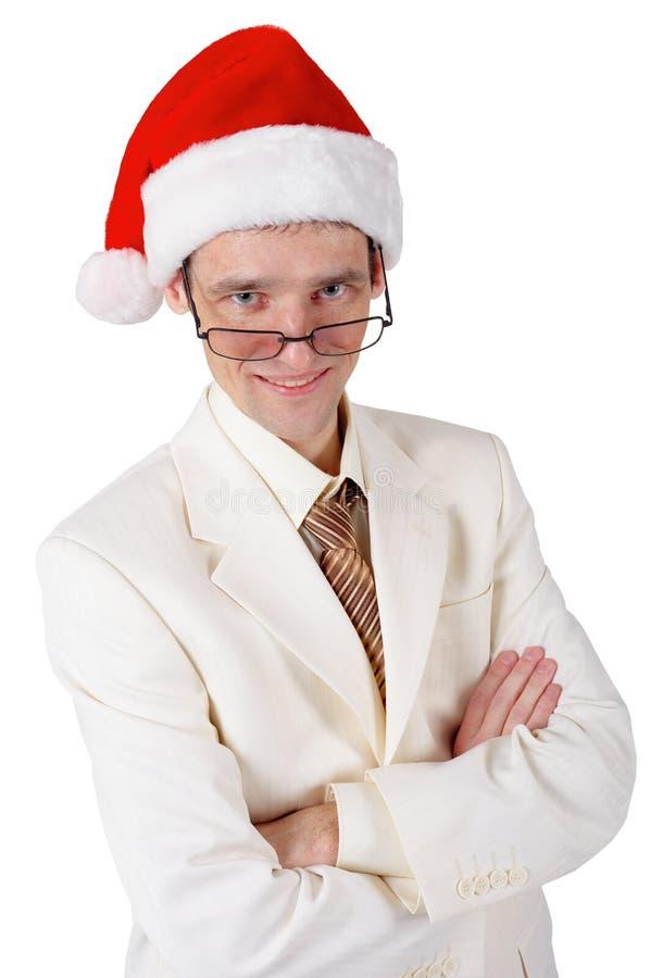 Le affärsman i en julhatt royaltyfri foto