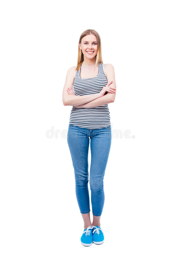 Le anseende för ung kvinna med vikta armar royaltyfri bild