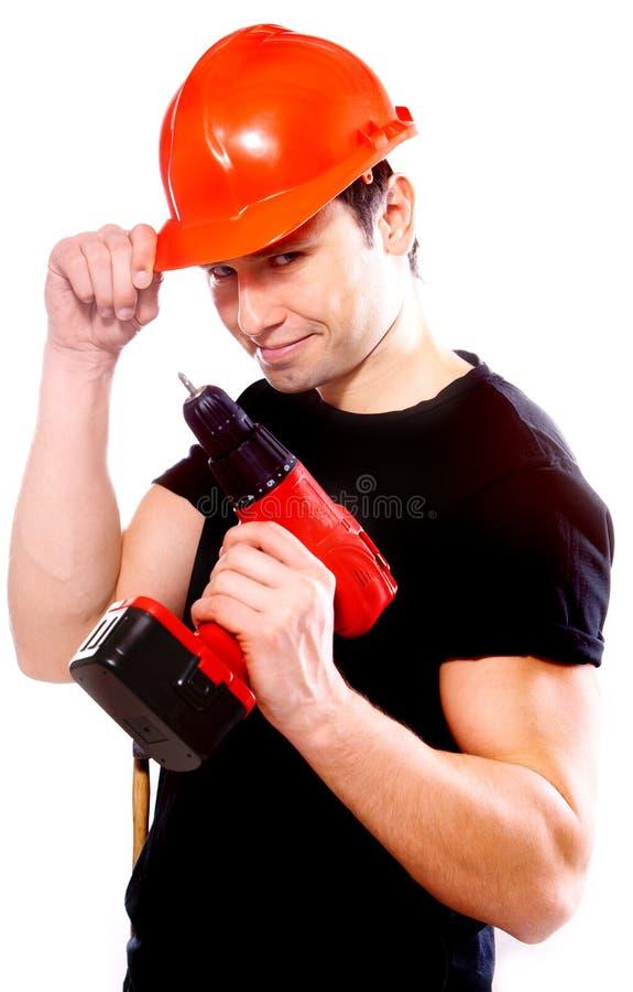 le arbetare för konstruktionsdrill arkivfoton
