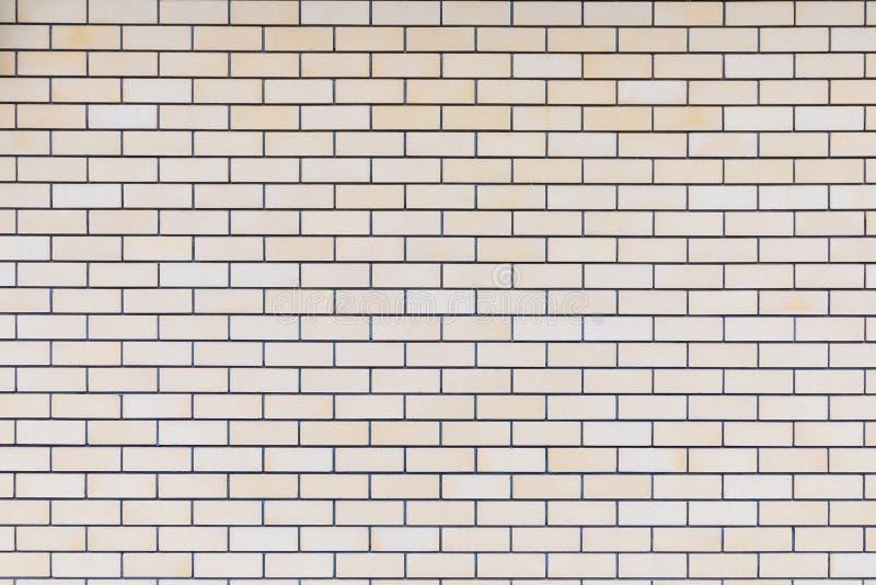 Le backround ou la texture du mur de briques jaune, beige ou brun intéressant idéal du bâtiment image libre de droits