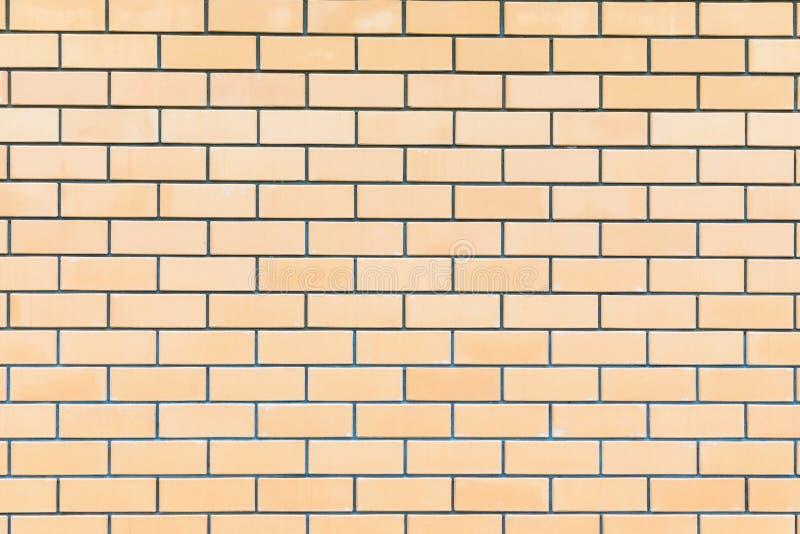 Le backround ou la texture du mur de briques jaune, beige ou brun intéressant idéal du bâtiment photographie stock libre de droits