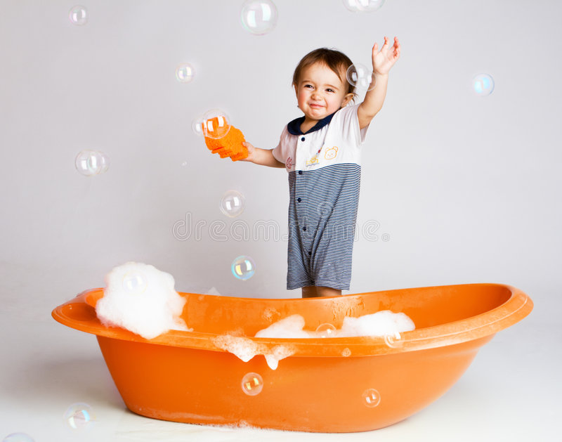 le bain heureux prennent à photo stock