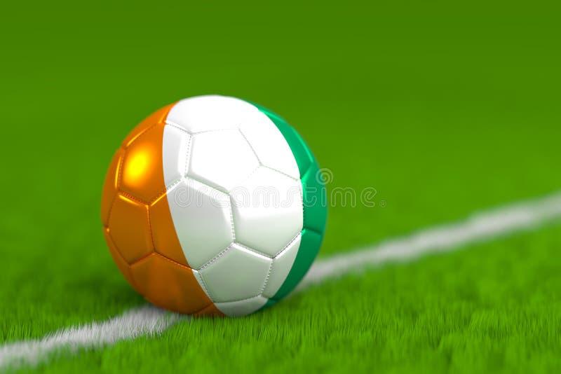Le ballon de football avec le drapeau ivoirien 3D rendent photo libre de droits