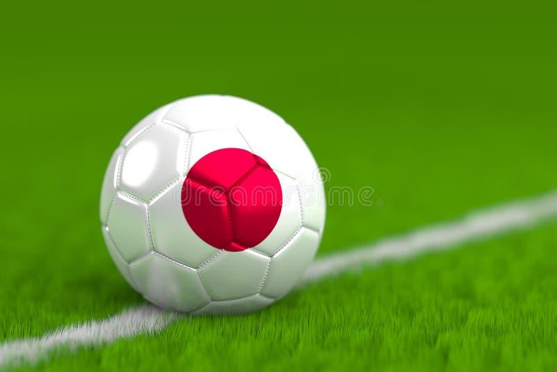 Le ballon de football avec le drapeau japonais 3D rendent photos libres de droits