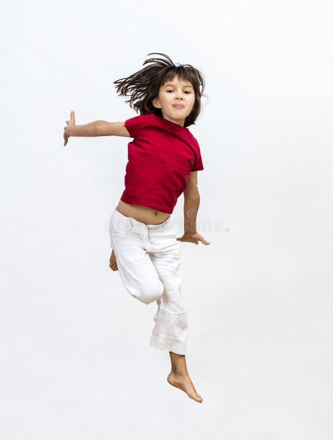 Le barnbanhoppningen som uttrycker framgång, öppnar dynamisk barndom och, mindedness royaltyfria bilder