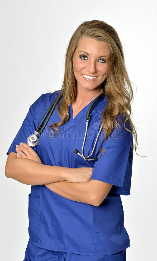 Le beau professionnel de soins de santé dans le bleu frotte photo stock