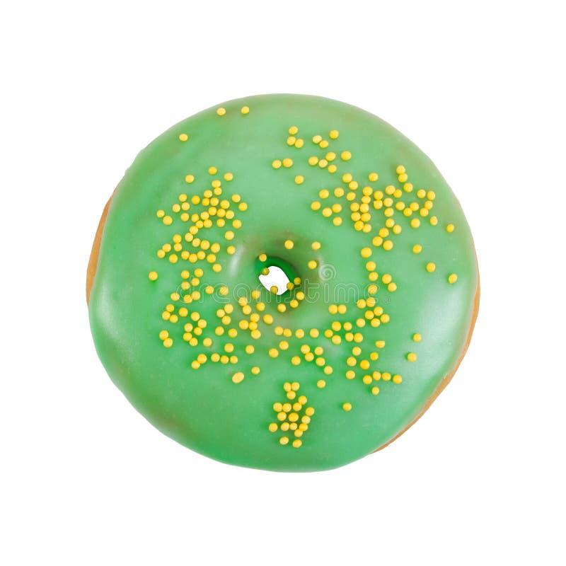 Le beignet avec le lustre vert et le jaune arrose d'isolement photo libre de droits