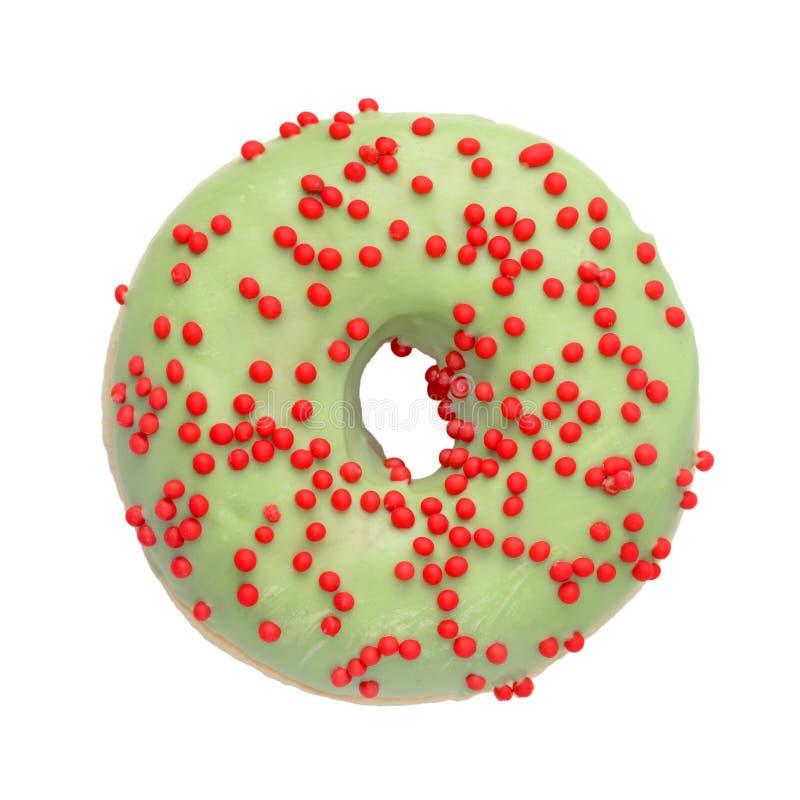 Le beignet vert avec arrose d'isolement photo libre de droits