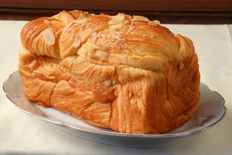 Le beurre gloden le pain images libres de droits