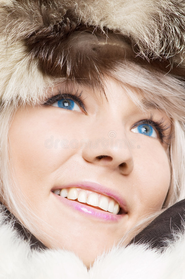 le bleu contacte la femme de fourrures photos stock