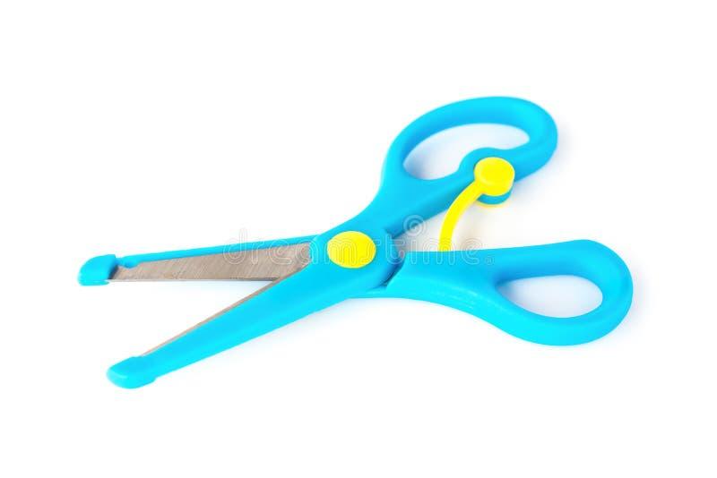 Le bleu handcraft des ciseaux pour des enfants sur le fond blanc image libre de droits