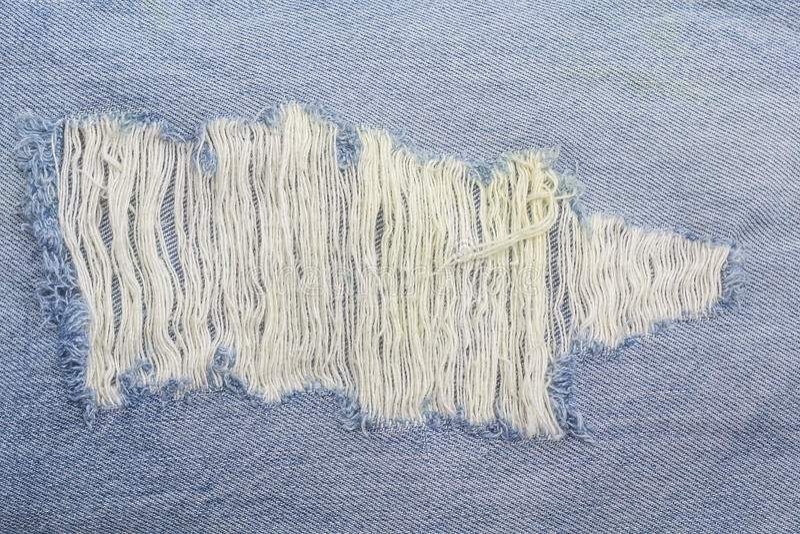 Le bleu texturisé rayé a employé le fond de toile de vintage de denim de jeans photo libre de droits