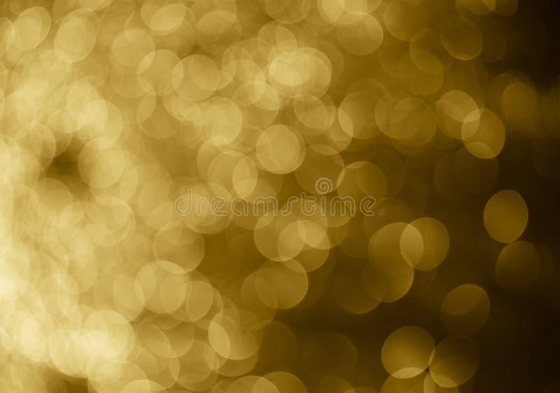 le bokeh abstrait de fond d'or entoure pour le fond de Noël photo stock