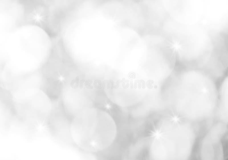 le bokeh blanc et gris abstrait allume le fond photo stock