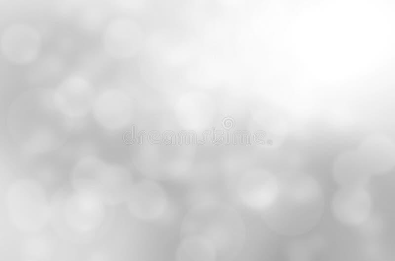 le bokeh blanc et gris abstrait allume le fond photographie stock