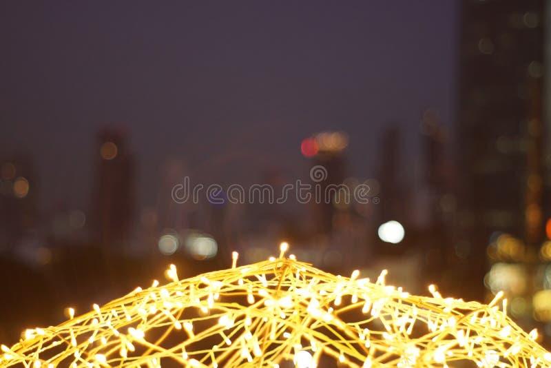 Le bokeh d'or de lumière de LED a brouillé le fond abstrait de modèle photos libres de droits