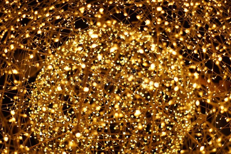 Le bokeh d'or de lumière de LED a brouillé le fond abstrait de modèle photo libre de droits