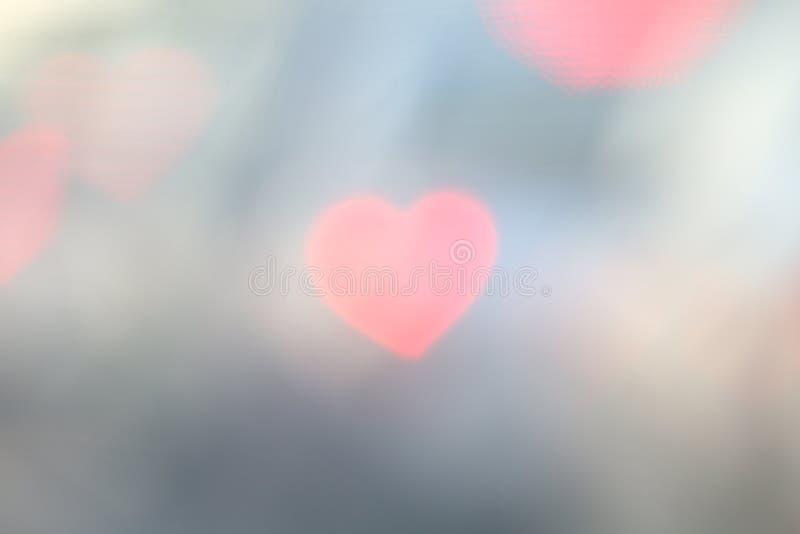 Le bokeh en forme de coeur de Valentine Soft sur le bokeh coloré mou d'éclairage de vintage de fond pour le papier peint de conte photos libres de droits