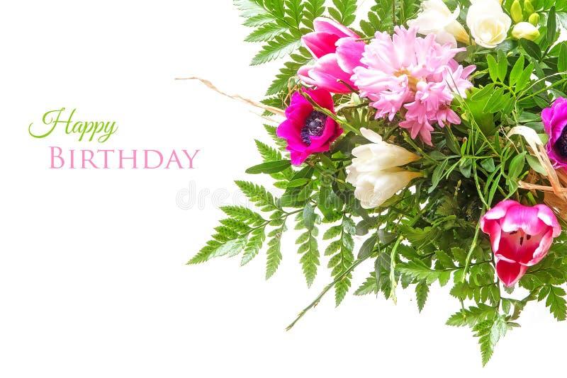 Le bouquet du ressort fleurit sur le blanc avec le texte, BIR heureux photographie stock libre de droits