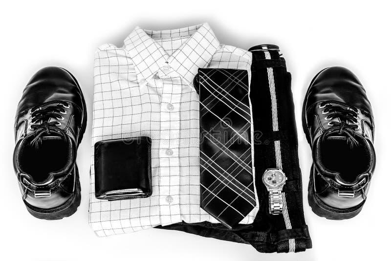 Le bouton blanc des hommes vers le haut de la chemise avec la montre de lien chausse le pantalon images libres de droits