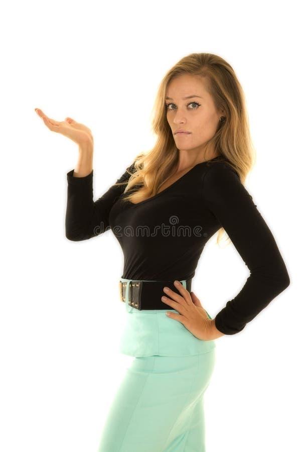 Le côté vert supérieur noir de chemise de femme distribuent photo libre de droits