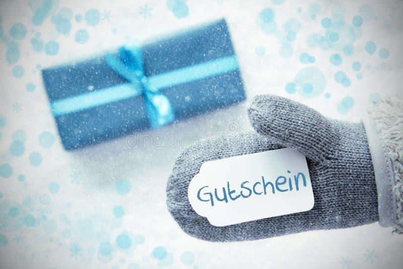 Le cadeau de turquoise, gant, texte Gutschein signifie le bon image stock