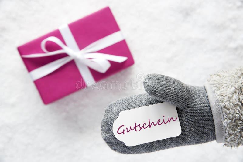 Le cadeau rose, gant, Gutschein signifie le bon photographie stock