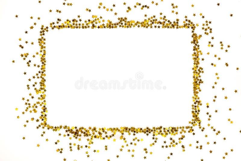 Le cadre d'or en forme d'étoile de paillettes a arrangé sous une forme rectangulaire photos stock