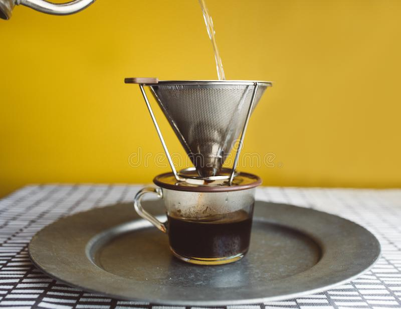 Le café de lumière naturelle se renversent plus de photographie stock libre de droits