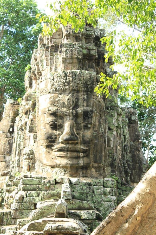 Le Cambodge - porte de visages images stock