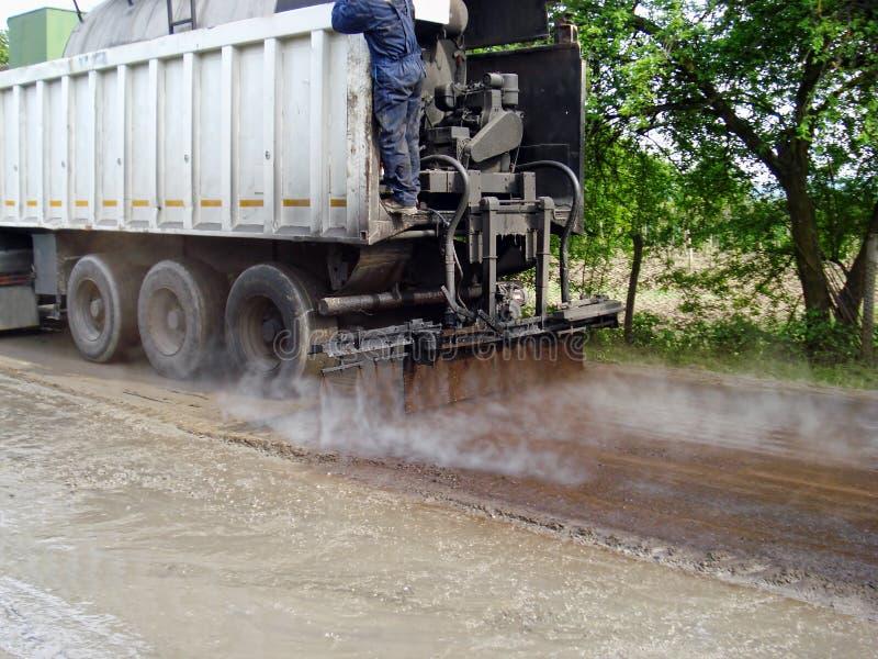 Le camion fonctionne la route photo stock