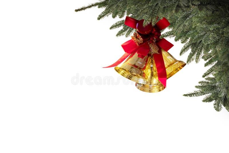 Le campane dell'oro di Natale hanno isolato il fondo bianco per la cartolina d'auguri fotografia stock