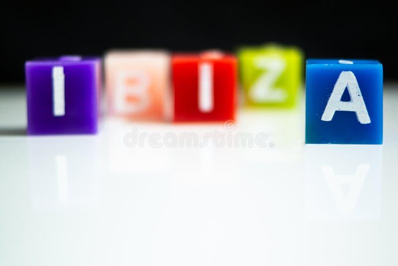Le candele spiegano la parola IBIZA fotografia stock